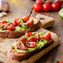 Warm toast wth avocado and cherry tomatoes